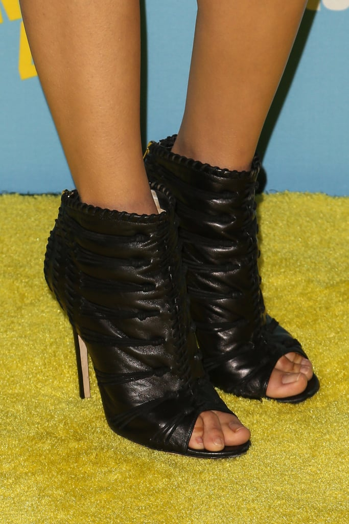 Nina Dobrev injected an edgier sensibility to her minidress ensemble with leather Jimmy Choo peep-toe booties.