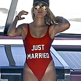 Hailey Baldwin looked smokin' hot in a red one-piece while vacationing with pals in Miami in July 2016.