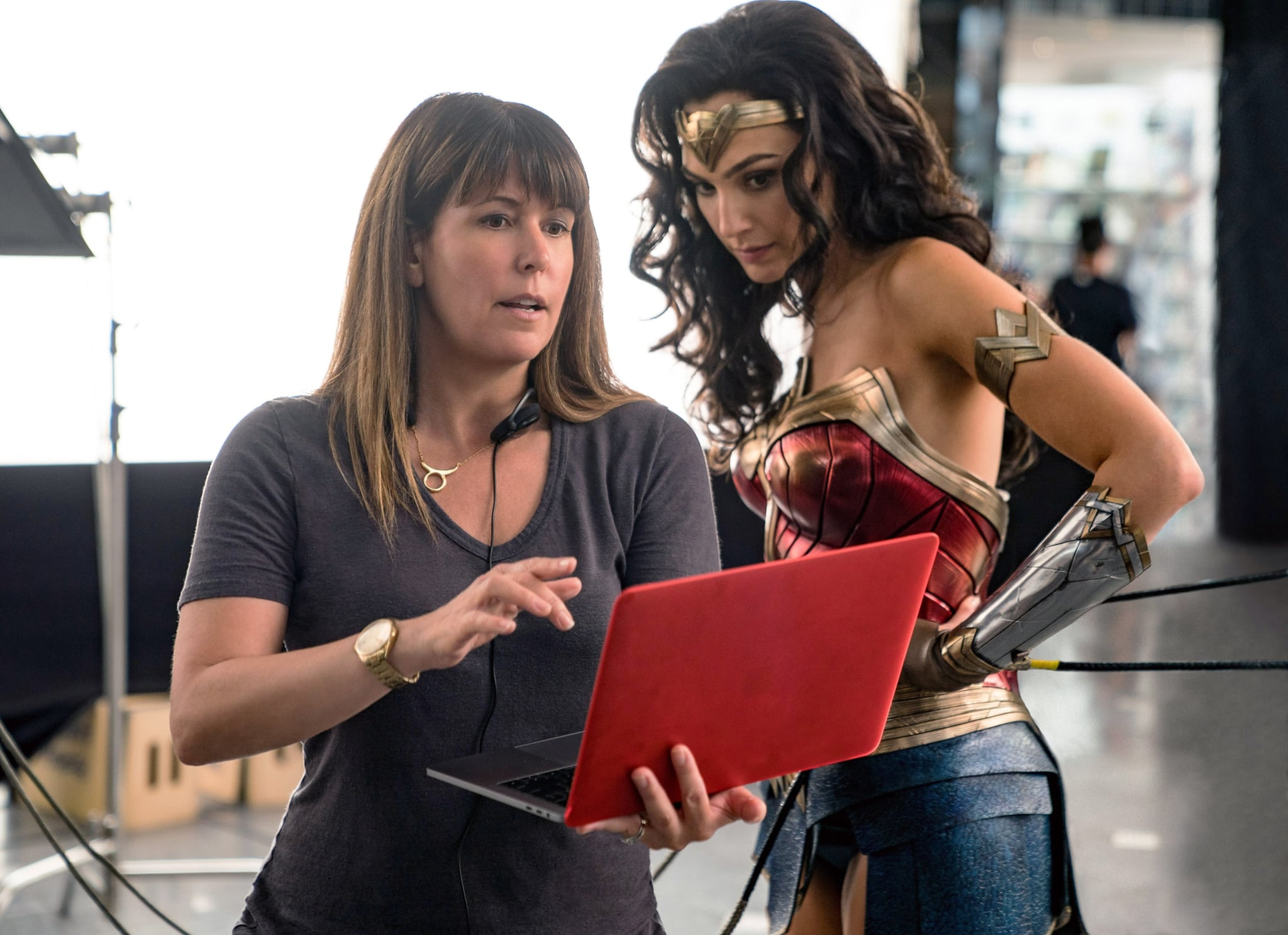 WONDER WOMAN 1984, from left: director Patty Jenkins, Gal Gadot, on-set, 2020. ph: Clay Enos /  Warner Bros. / Courtesy Everett Collection