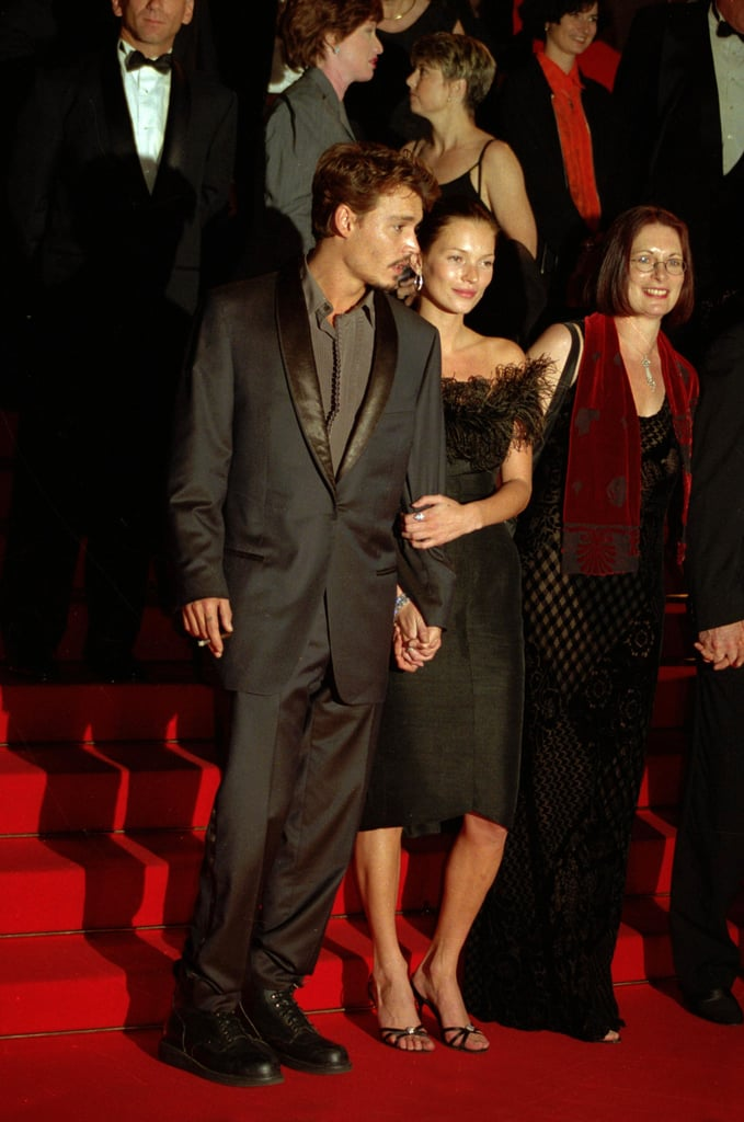 When She Held His Arm as They Posed For the Camera