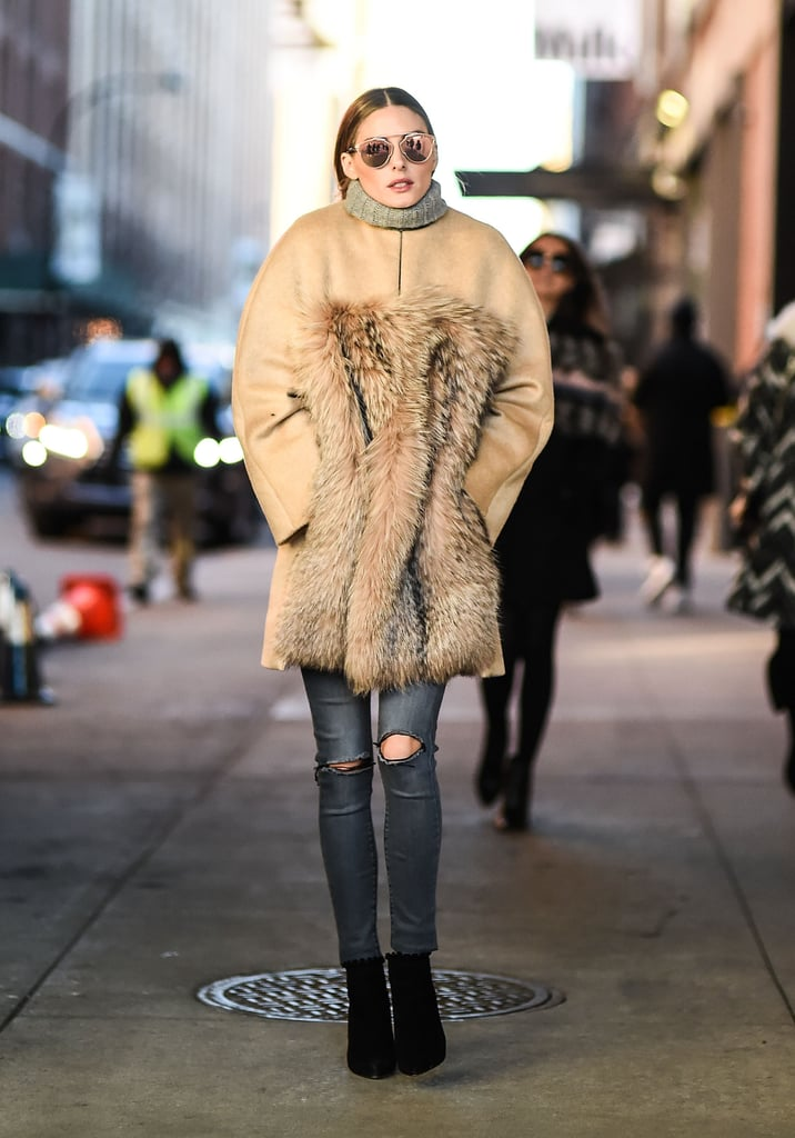 Olivia bundled up in a MaxMara coat, Black Orchid denim, and a pair of Tabitha Simmons booties between shows. She topped the look off with Dior sunglasses.