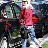 Kate Bosworth wore in a red cable-knit sweater.