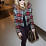 Chloë Moretz kept the focus on her plaid peacoat by keeping the rest of her outfit quiet. We couldn't help but notice that ultraluxe Louis Vuitton duffel, though!