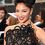 Promoting Men in Black 3 in London, an intricate dress called for an updo. Nicole's was backcombed for volume at the front but slicked under at the back. Red lipstick and plenty of highlighter under the brows were the key to the glamorous makeup look.