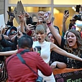Taylor Swift posed with excited fans at the One Chance premiere.