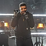 Drake took to the stage dressed in black.