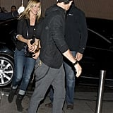 Jennifer Aniston and Justin Theroux hopped out of their car and walked into a restaurant in Paris.