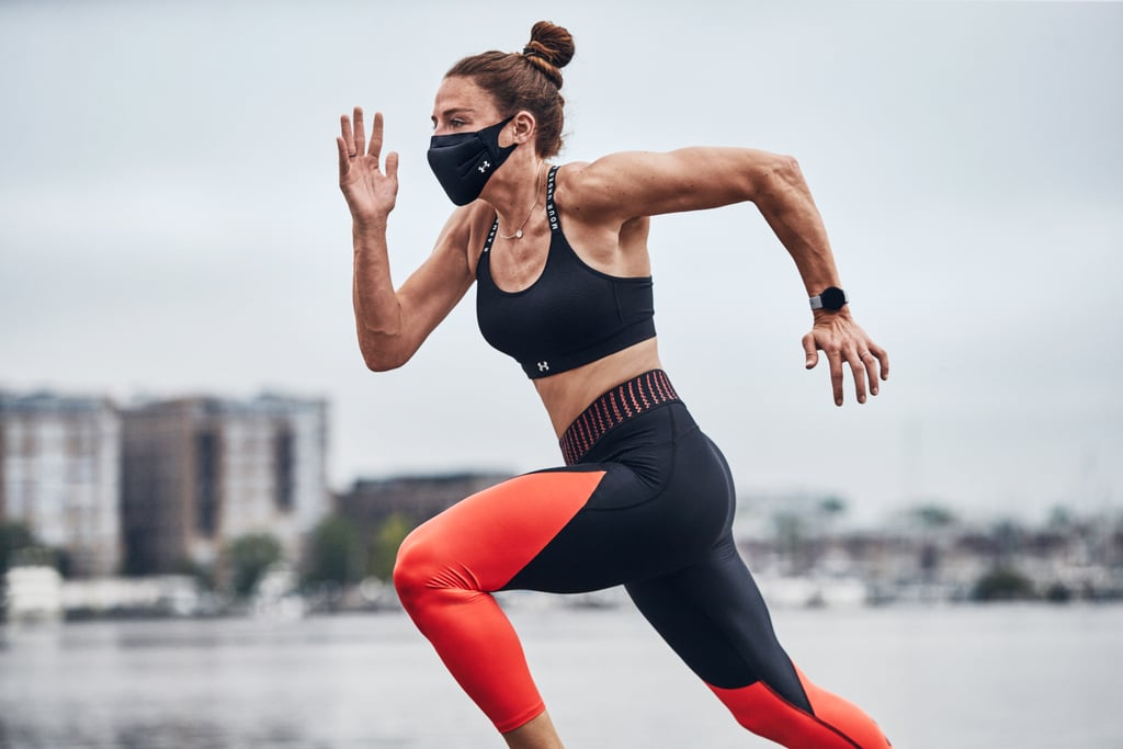 """As gyms reopen and more people come together to break a sweat, you will most likely be required to wear face coverings indoors and if you're exercising outside near other people. On June 11, Under Armour released a performance face mask for just that. The Sportsmask is a reusable, water-resistant covering with a three-layer fabric that feels cool, is breathable, and has been treated with PROTX2, which, according to a news release, is a """"non-metal anti-microbial technology"""" shown in lab tests to destroy 99.9 percent of COVID-19 within 10 minutes. (Note: the US Environmental Protection Agency is reportedly reviewing the effectiveness of PROTX2 on the Under Armour mask specifically.) """"Athletes may find it challenging to work out in general-purpose or homemade masks for a number of reasons. They can slip off your face, sometimes the fabric isn't breathable or designed to wick sweat properly,"""" Cara McDonough, vice president of accessories and licensing at Under Armour, told POPSUGAR through an Under Armour representative. """"We engineered the UA Sportsmask to solve these common issues."""" She pointed to the flexible nose bridge that secures the mask in place, the cooling effect of the fabric, and its breathability as key factors that set the Sportsmask apart from other face coverings. Under Armour's athletes in the US, including the NBA's Steph Curry and NFL's Deonte Harris, received the first batch of samples to test them out, according to Forbes. """"Whenever you have something covering your mouth and nose, it's going to feel a little restrictive at first,"""" Harris said. """"Other masks don't give you as much airflow as this mask does, so it's one of the best options for protection during performance. It's not designed for contact sports, so I won't be using it on the field, but it's perfect for that extra level of protection when I'm working out with others and social distancing is encouraged."""" You should wash the Sportsmask the same way you would any other piece of athletic app"""