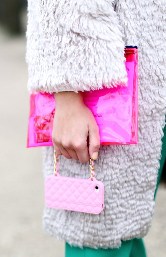 This style setter took the feminine route in a hot-pink clutch and baby-pink quilted iPhone case.