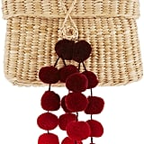 We imagine this Nannacay straw baby roge red pom pom bag ($140) was made for vacation.