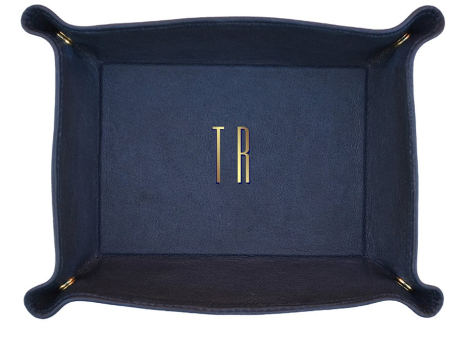 A personalized Clare Vivier leather tray ($74) is as pretty as it is practical. She'll think of your big day whenever she fishes something off of it and can count on it keeping things tidy wherever she roams — the snap corners and malleable fabric make it easy to pack.