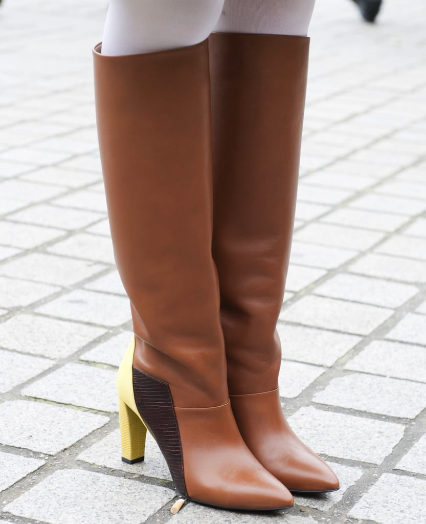 Yellow heels added a fresh touch to these chic brown riding boots.