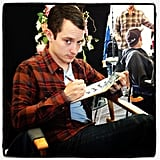 Angela Kinsey snapped a picture of a crossword-happy Elijah Wood on the set of Wilfred. Source: Instagram user angelakinsey