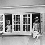 Peekaboo! They popped out of their playhouse in 1937.
