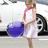 Violet Affleck carried a balloon.
