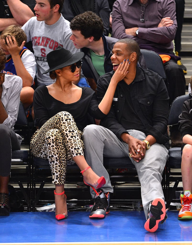 Beyoncé admired her man while wearing leopard-print A.L.C. pants and neon ankle-strap cap-toe Christian Louboutin pumps during a New York Knicks game in April 2012.