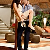 Robert Pattinson carries Kristen Stewart in Breaking Dawn Part I.