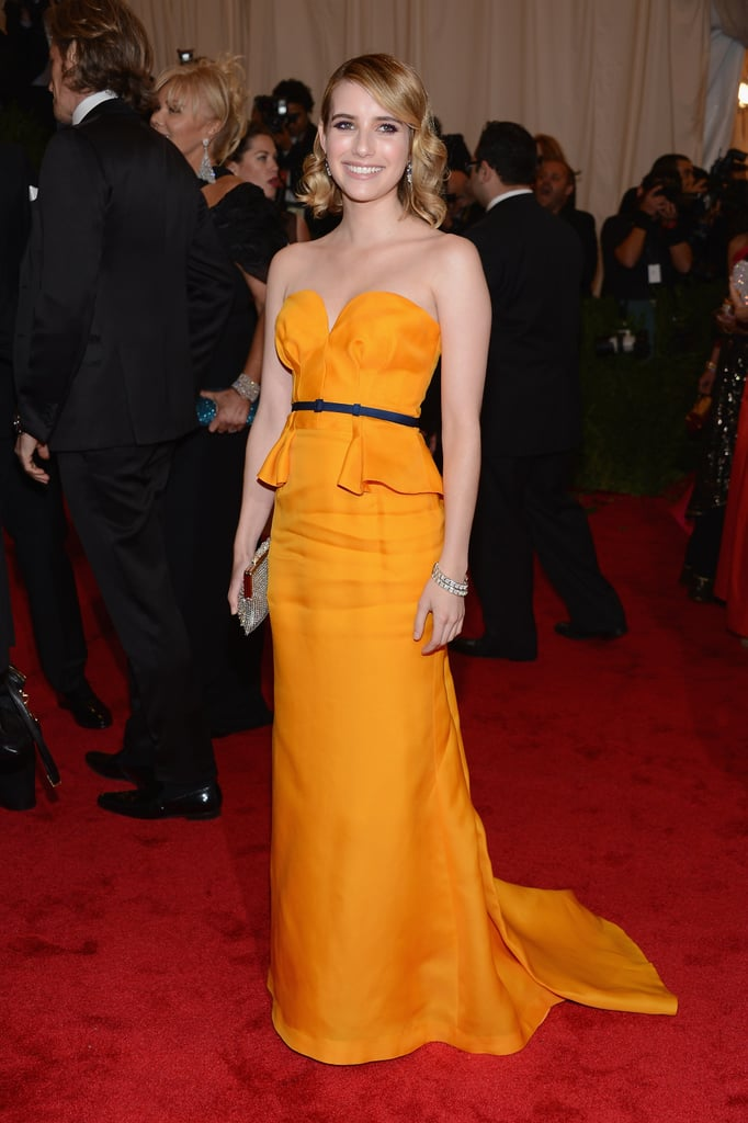 Emma wore a gorgeous marigold-colored Escada gown on the red carpet at the Met Gala in May 2012.