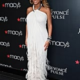 Beyoncé Knowles in a white Lanvin gown at a fragrance launch.