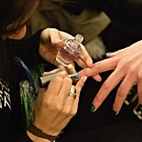 11. There are pop-up nail salons. Be careful where you step! Manicurists will literally be crawling on the floor to give models quick pedicures, while others focus on creating the nail art trends we all will want to copy next season.  12. Drugstore products reign supreme. While plenty of pros use the high-end stuff, many rely on trusty favorites like L'Oreal Paris Elnett Satin Hairspray ($13), Rosebud Perfume Co. Rosebud Salve ($6), and Embryolisse Lait-Crème Concentré ($28) to create the looks. Mario Badescu Rose Water Spray ($7) is another affordable backstage staple.  13. Backstage photos are not always revealed in real time. For the most part, backstage photos of the final hair, makeup, and nail looks are embargoed until the show happens (and don't even think about releasing looks of the clothes before the main event!). So the behind-the-scenes images on Instagram were probably taken hours earlier. Reporters get around this by posting on a piece of the puzzle in real time, so a red lip here and a braid there are allowed.