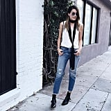 A White Tank Top, Distressed Denim, Black Booties, and a Skinny Scarf