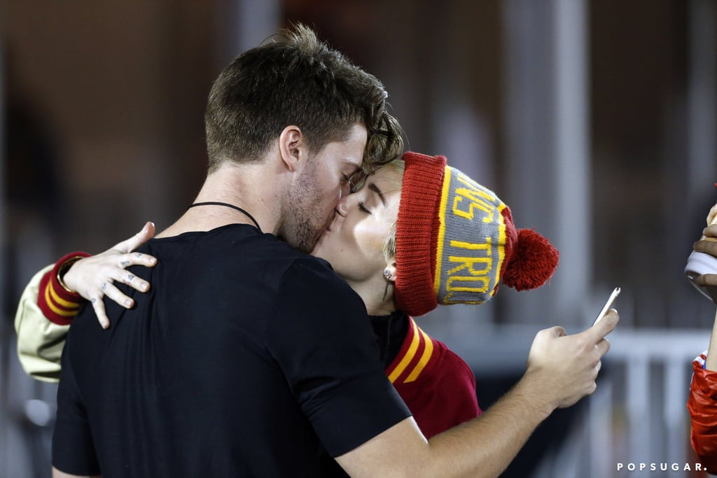 Yep, Miley Cyrus and Patrick Schwarzenegger are definitely dating. The couple made their new romance public when they were spotted sharing a sweet kiss at the UC Berkeley vs. USC game in LA on Thursday. Miley smiled from ear to ear as she nuzzled with her new beau and posed for kiss selfies in the stands. She also made her team allegiance very known by wearing both a jacket in the USC team's colors and a USC Trojans beanie. (Patrick is currently a sophomore at the LA-based university.) While it looked as if the pair captured plenty of snaps, neither of them has yet to post the picture on social media, so maybe they are keeping the photo private for now. Miley and Patrick reconnected in October after she wrapped up her worldwide Bangerz tour. The son of Arnold Schwarzenegger and Maria Shriver had previously admitted that he had a crush on the singer, and the two briefly dated in 2011 while Miley was on a break from then-boyfriend Liam Hemsworth. On Wednesday, Miley and Patrick attended the Still Alice Q&A in LA to support Patrick's famous mom, who acted as executive producer for the film.