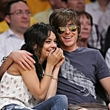 The two had a case of the giggles at a basketball game in April 2009.