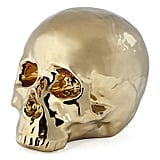 Go glamourous and gold with a metallic skull ($15) chic enough to keep on display after Halloween.