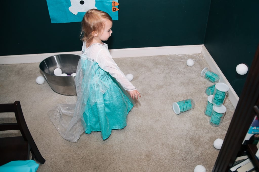 Anna created a game of Snowball Bowling with plush snowballs ($16) and plastic cups filled with tissue paper. The result was cute and totally perfect for toddlers!