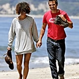 Halle Berry and Olivier Martinez walked hand in hand on the beach.