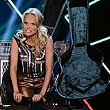 Kristin Chenoweth made a dramatic entrance inside a guitar case.