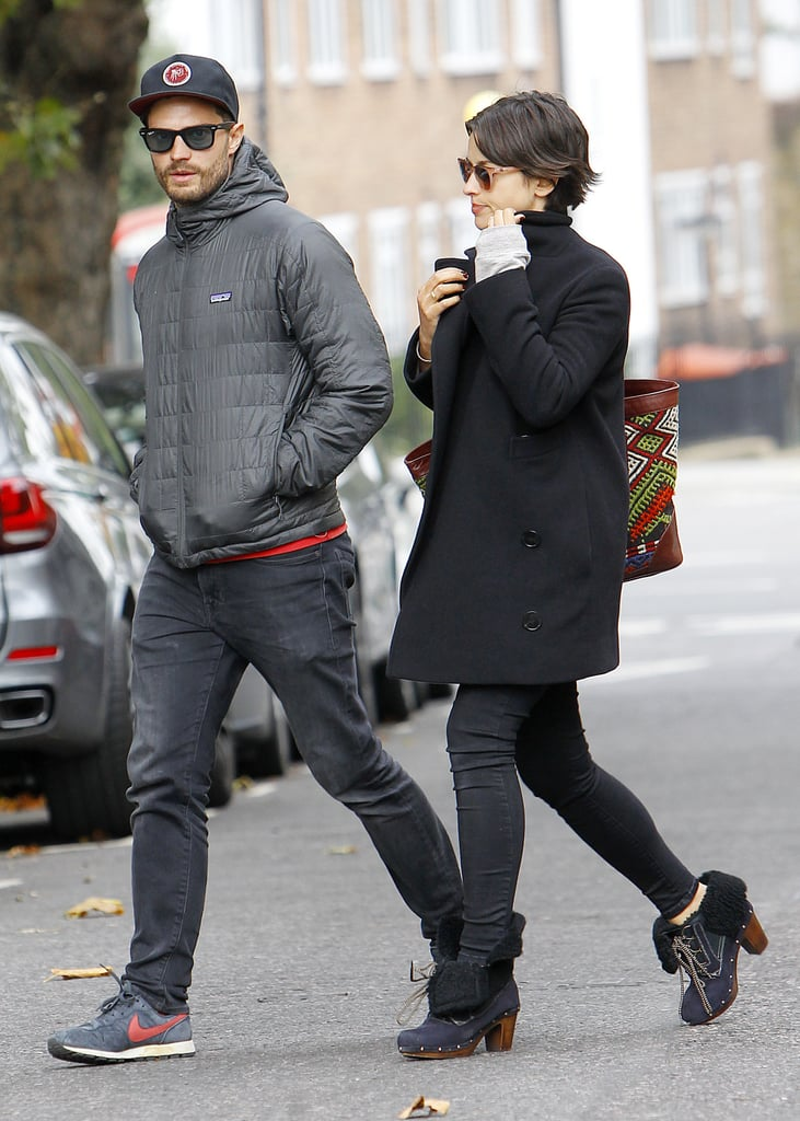 Jamie Dornan and his wife, Amelia Warner, were bundled up for a walk around London on Tuesday. The couple are back together in England after Jamie took a quick trip to Scotland for the Alfred Dunhill Links Championship at St. Andrews last week. It's no surprise that he looked hotter than ever during his golf games — one round could have been mistaken for a modeling shoot! While Jamie's athletic side was on display, it's not the most we've seen of the star lately since he went shirtless during a beach holiday back in September. Jamie crawled on the sand in nothing but swim trunks, and while it may have given some fans Fifty Shades of Grey flashbacks, his look was a lot less creepy than we're used to seeing on screen.
