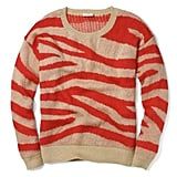 The red-and-camel color combo on Club Monaco's Naomi patterned sweater ($99, originally $130) is sure to make a statement any way you decide to wear it.