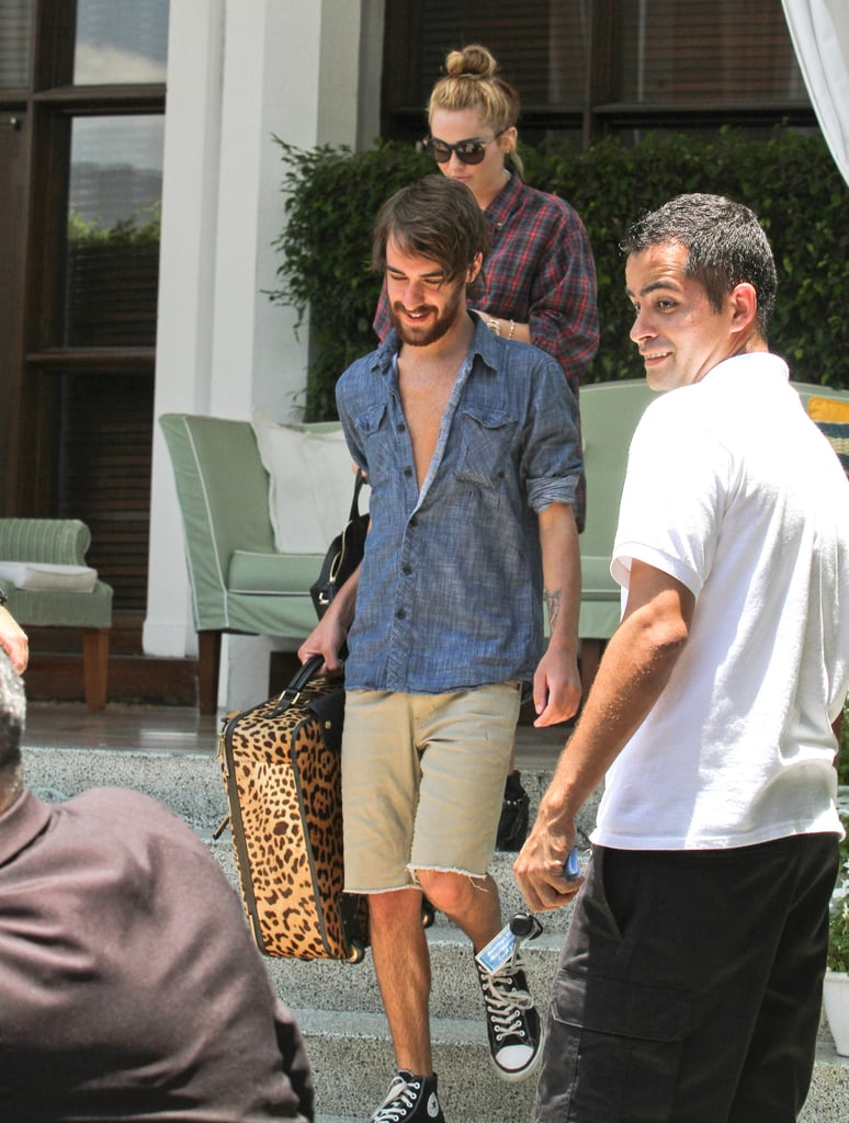 Cheyne Thomas carried Miley Cyrus's luggage out of her Miami hotel.