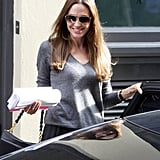 Angelina Jolie carried a script leaving a meeting in London.