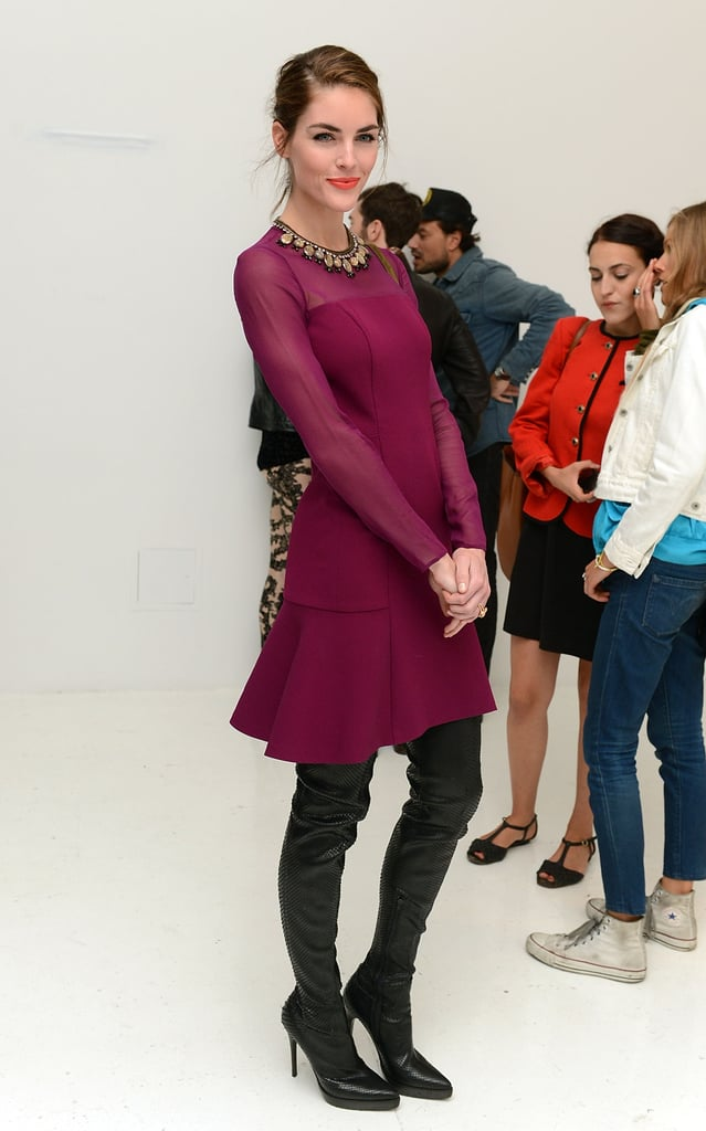 Hilary Rhoda gave a fit-and-flare berry-hued dress by DKNY an edgy Fall update with a pair of thigh-high black boots.