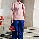 Binx Walton Rocked a Pink Polo Shirt, Blue Wide-Leg Trousers, and Vans After the Ferragamo Show