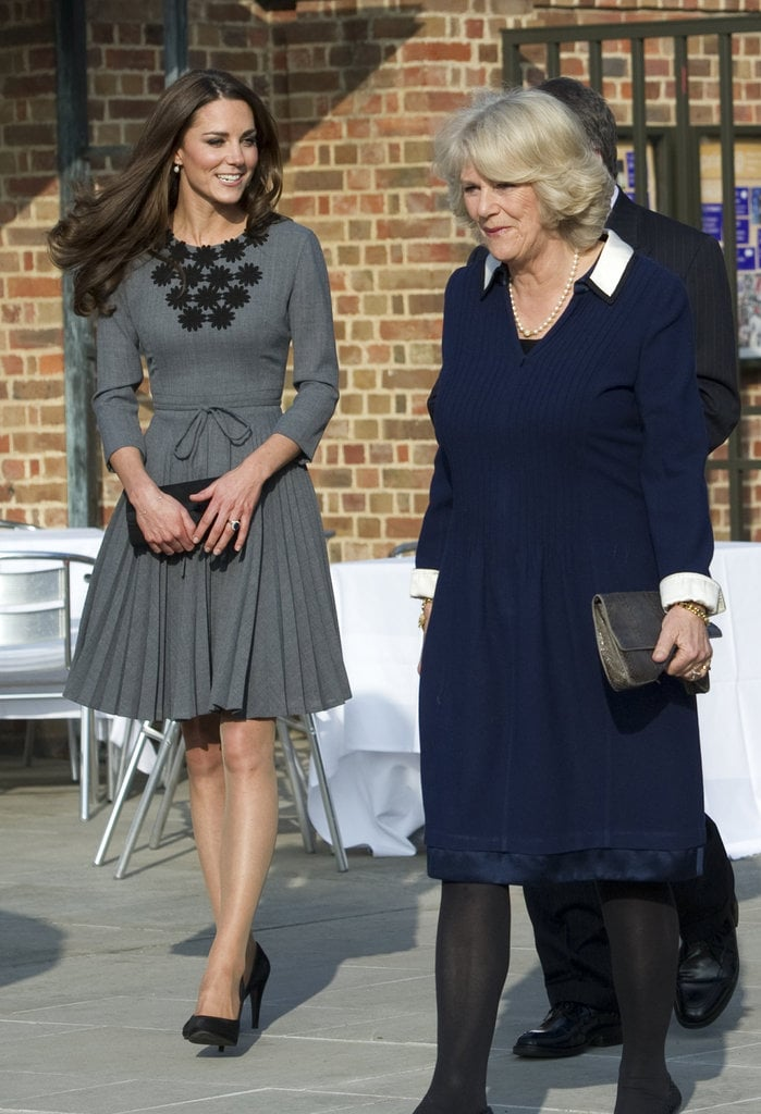 Duchess Catherine wore a ladylike gray Orla Kiely dress to join Prince Charles and Camilla to visit the Prince's Foundation for Children.