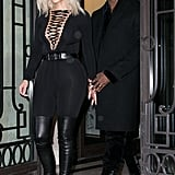 Kim wore the same Givenchy separates during Paris Fashion Week, showing off her curves with a thick black belt and skintight pants.