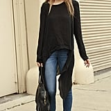 An asymmetrical sweater adds more interest to a basic denim look.