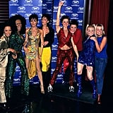 The Spice Girls cozied up to their wax figures at London's The Rock Circus in December 1997.