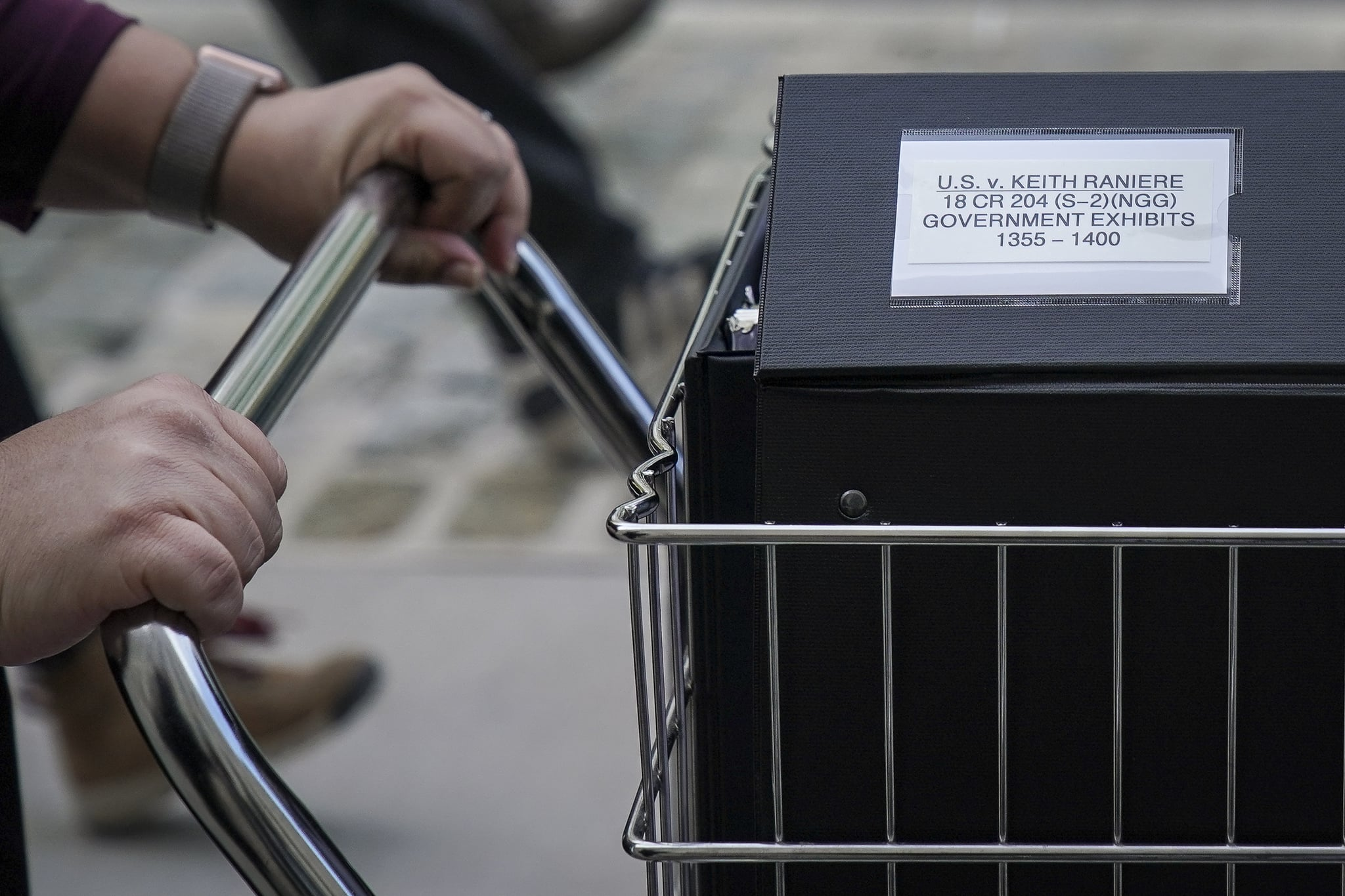 NEW YORK, NY - MAY 7: Staff and members of the prosecution team push carts full of court documents related to the U.S. v. Keith Raniere case as they arrive at the U.S. District Court for the Eastern District of New York a, May 7, 2019 in the Brooklyn borough of New York City. Opening arguments begin on Tuesday morning for the trial of Keith Raniere, the leader of the alleged sex cult NXIVM. Raniere, who could potentially face life in prison, has pleaded not guilty to sex trafficking, racketeering and other charges. (Photo by Drew Angerer/Getty Images)