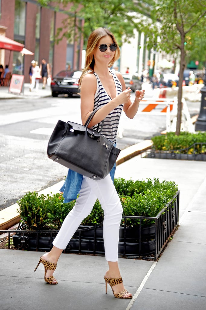 This is one supermodel who loves her heels, but when it comes to these Miu Miu mules, we totally get Miranda's adoration. And, we love the way she mixed prints with a striped tank.