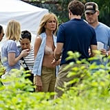 Newly-engaged Jennifer Aniston bared a bit more than usual as she filmed scenes of her new film, We're the Millers, on August 20.