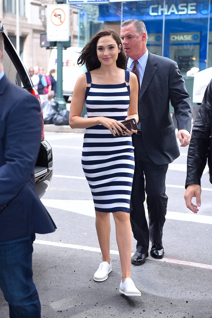 White sneakers are always a good choice for the warmer months, but Gal's decision to pair the canvas shoes with a tight, striped, knee-length dress proves, yet again, that sneakers work with any type of outfit.