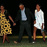 Barack was joined by Michelle and Malia when they returned to Washington DC after spending time in Martha's Vineyard in August 2014.