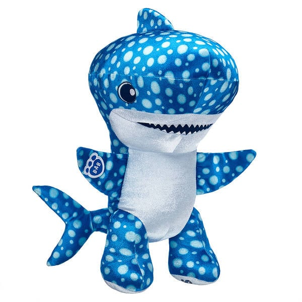 "Shark Week is almost upon us, which means it's the perfect time to treat your baby shark to one of Build-A-Bear's new shark-inspired stuffed creations. From the ""ferociously fun"" Tiger Shark ($29) with its gray stripes and floppy plush fins to the ""jawsome"" Whale Shark ($29) with spotted blue fur, these stuffing-filled dolls take sharks from scary to snuggly in an instant. Just look at their little fins! The full Shark Week collection, available in stores and online, includes two shark-themed slap bracelets for kids and plenty of shark-themed accessories for their plushy new friends. Build-A-Bear also offers a Shark Week Gift Set ($63) featuring the shark of your choice covered head to fin in beach-appropriate swimwear. Check out the completely chomp-tastic collection ahead!       Related:                                                                                                           Oh I Just Can't Wait to Be King of the Stuffed Animals With This Build-A-Bear Lion King Collection"