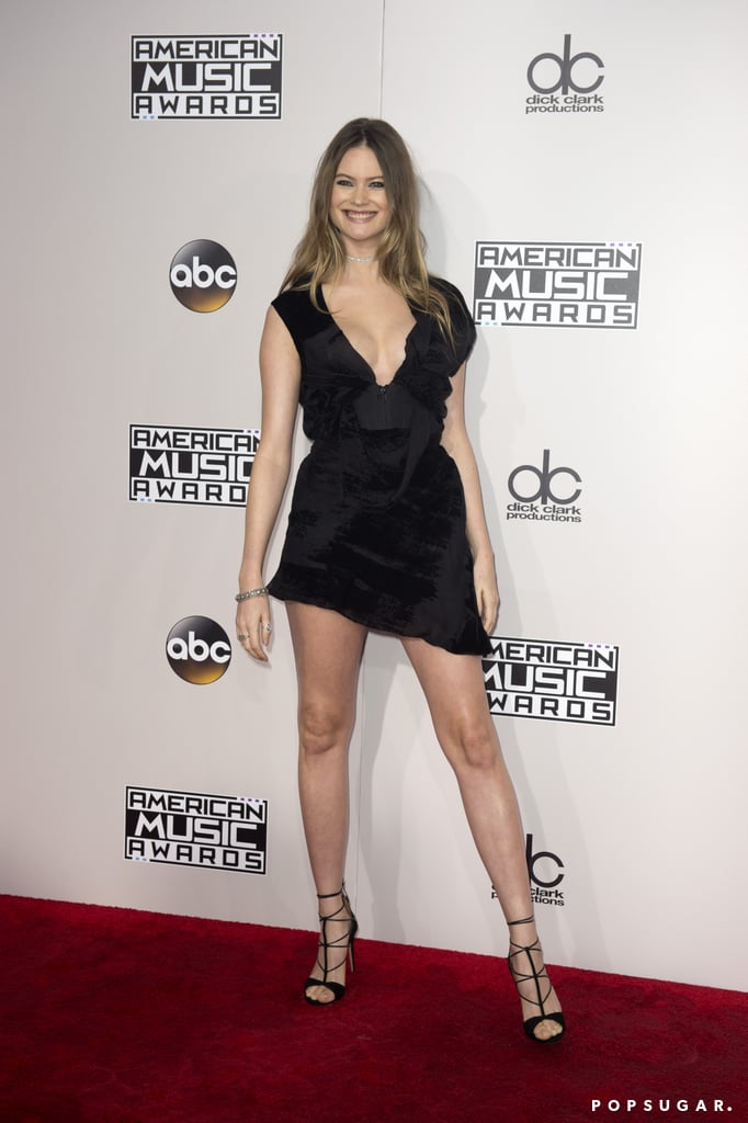 "Behati Prinsloo was smiling from ear to ear when she stepped out for the American Music Awards in LA on Monday. The Victoria's Secret Angel, who welcomed daughter Dusty Rose with husband Adam Levine in September, showed some serious leg in a black minidress as she struck poses on the red carpet before making her way inside the Microsoft Theater to watch her husband perform with his band Maroon 5 and Kendrick Lamar.   Although the Namibian beauty has been active on social media lately, her AMAs appearance marked her first red carpet outing since becoming a mum. Just last week, Adam shared a precious photo of the trio at the beach, writing, ""Everything I need is right here. (Beach optional)."" We're keeping our fingers crossed for more sweet family moments!      Related:                                                                                                           Adam Levine Shares the First Snap of His Little Girl, and It's Too Precious For Words"