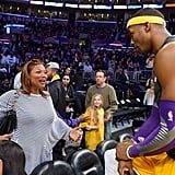 Queen Latifah stopped to talk to pal Dwight Howard before he warmed up for the game.