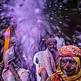Hindu devotees tossed colored powder at each other during Holi celebrations at the Banke Bihari Temple in Vrindavan, India.